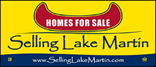selling lake martin logo black outline red canoe on yellow background